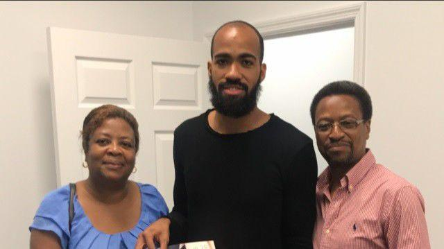 FAMILY TIME: Machel Cedenio, centre, poses for a photo with his proud parents, Diane, left, and Hayden.