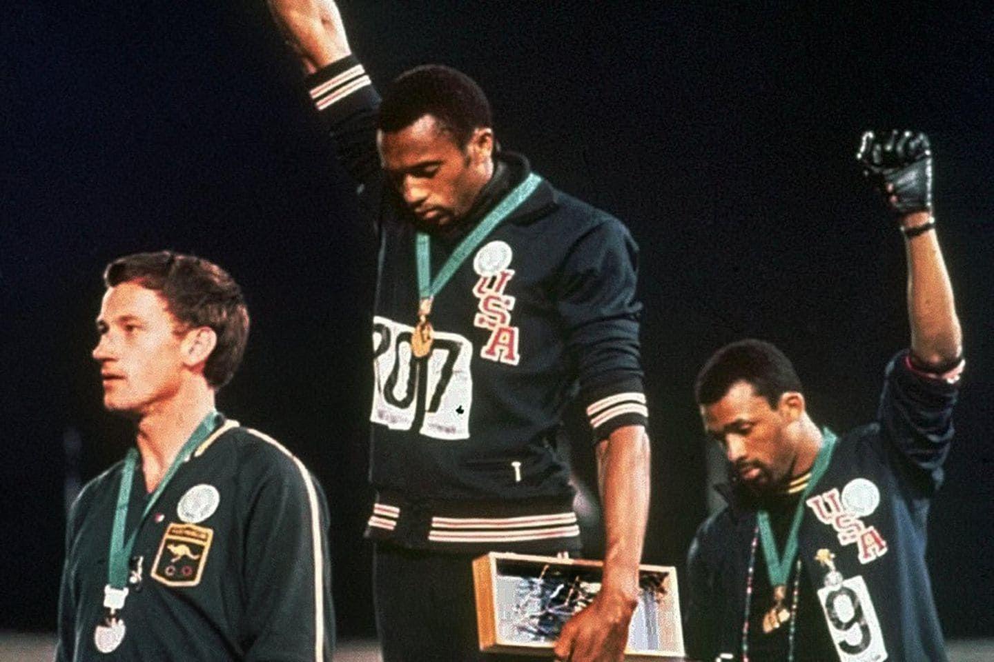 American track and field athletes Tommie Smith (C) and John Carlos (R), protest with the Black Power salute at the Summer Olympic games, Mexico City, Mexico, October 19, 1968. John Dominis/The LIFE Picture Collection via Getty Images 1968: John Carlos and Tommie Smith raise their fists in the Black Power salute